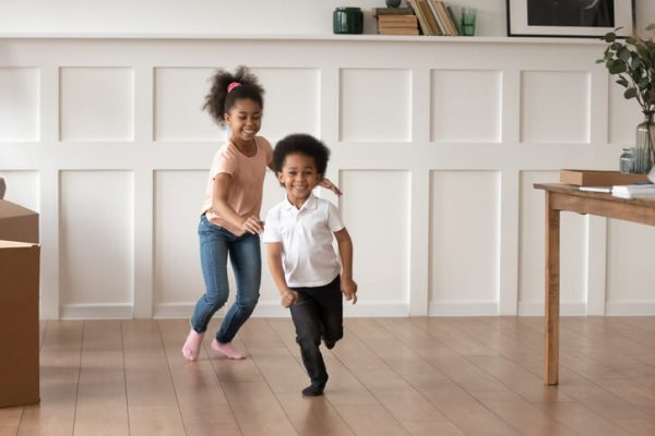 Excited preschooler kids have fun running at home