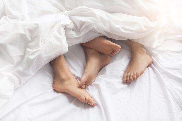 Young couple intimate relationship on bed