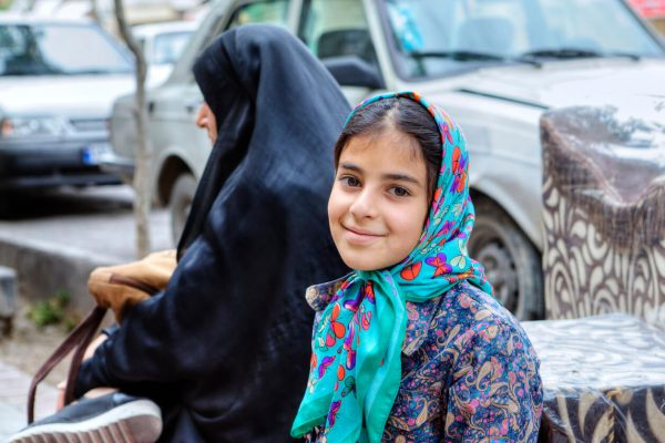 Portrait of a smiling Iranian teenage girl in hijab