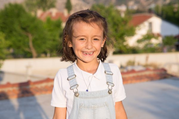 a Turkish girl smiling while outdoors